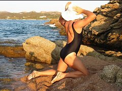 Swimsuit sexy crossdresser photo in the beach